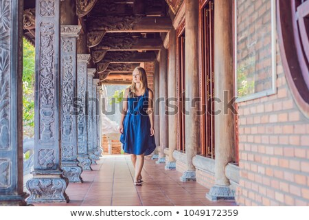 Young woman tourist in Pagoda. Travel to Asia concept. Traveling with a baby concept stock photo © galitskaya