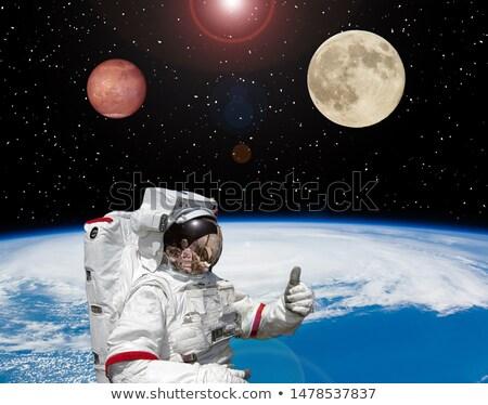 Astronaut gives the planet Mars Stock photo © studiostoks