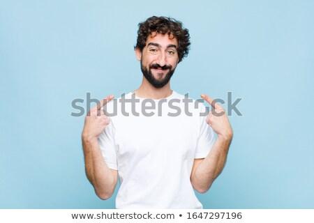 Ritratto soddisfatto giovani barbuto uomo piedi Foto d'archivio © deandrobot
