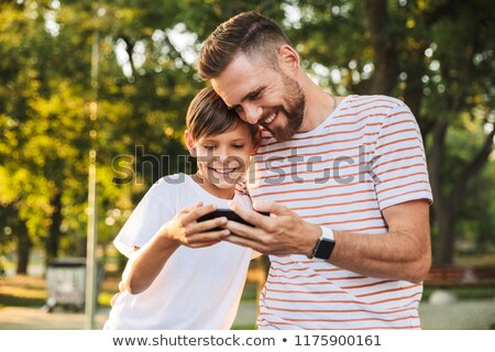Delighted father spending time with his little son Stock photo © deandrobot