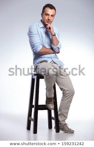 Hombre guapo pensando sesión taburete azul traje Foto stock © feedough