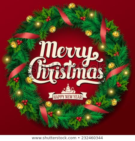 christmas wreath with mistletoe ribbon and gift stock photo © robuart