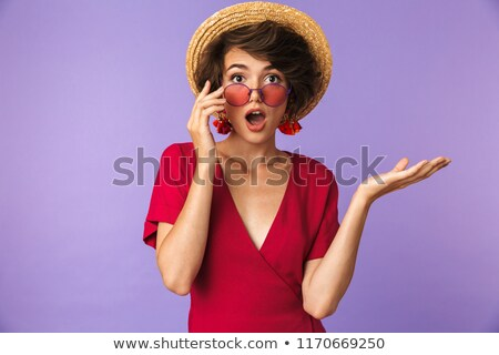 Shocked brunette woman in dress take off sunglasses Stock photo © deandrobot