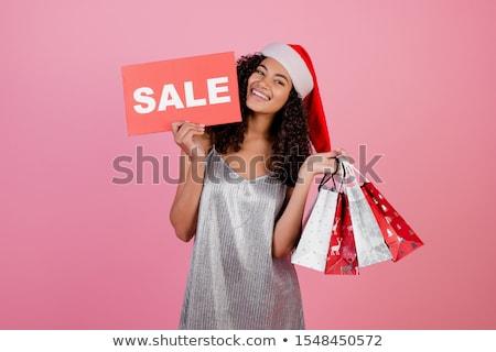 beautiful young woman wearing christmas hat stock photo © deandrobot
