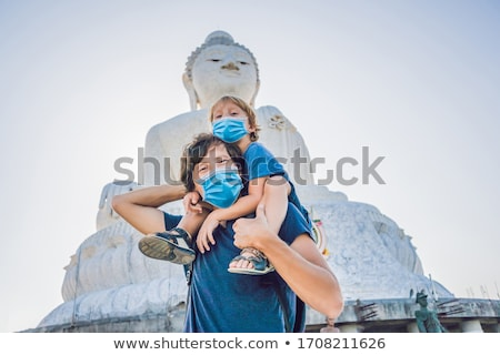 Father and son tourists on the Big Buddha statue. Was built on a high hilltop of Phuket Thailand Can Foto d'archivio © galitskaya