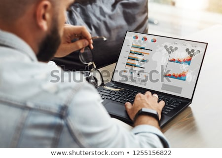 Freelancer with Laptop and Screens with Charts Stock photo © robuart