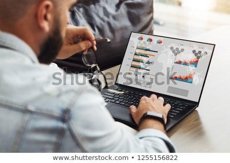 Freelancer laptop charts persoon werken gegevens Stockfoto © robuart