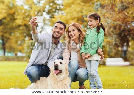 happy family with dog taking selfie in autumn stock photo © dolgachov