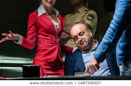 Defendant using the right to remain in silence during a police interrogation Stock photo © Kzenon