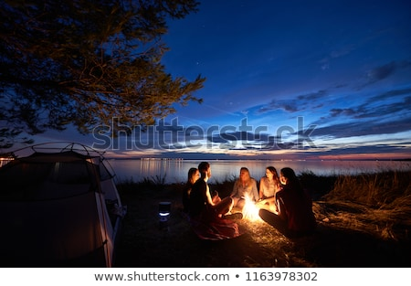 camping on nature person in tent by lake and trees stock photo © robuart