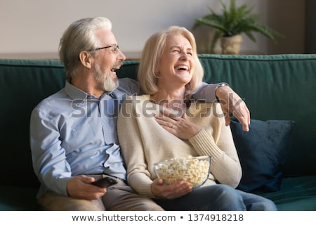 Viewers, couple family husband and wife watch TV Stock photo © studiostoks