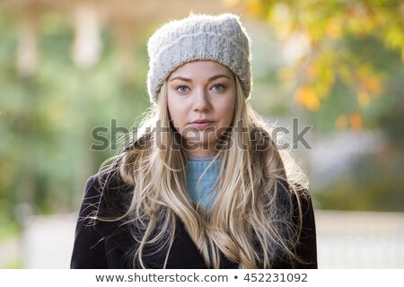 Headshot of young beautiful woman in warm clothes Stock photo © dariazu