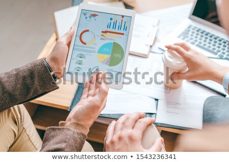 Genç erkek touchpad işaret finansal diyagram Stok fotoğraf © pressmaster