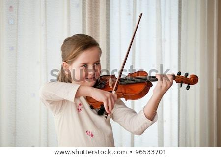 Portre genç kız öğrenme oynamak keman mutlu Stok fotoğraf © HighwayStarz