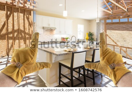 Stock photo: Male Contractor Hands Framing Completed Section of Kitchen Being