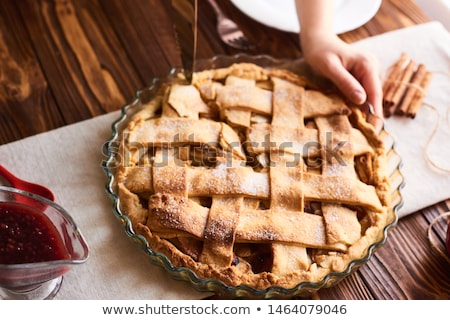 close up of hand with piece of apple pie on knife Stock photo © dolgachov