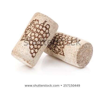 Wine cork with vintage corkscrew on wooden background. Stock photo © DenisMArt