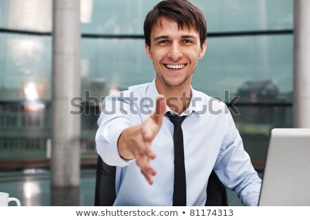 happy mature business man offering a welcoming hand stock photo © hasloo