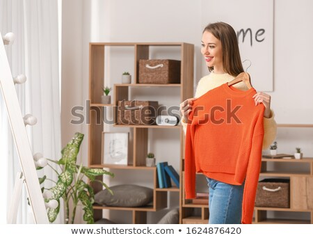 portrait of pretty fashionable woman trying new clothes fashion stock photo © hasloo