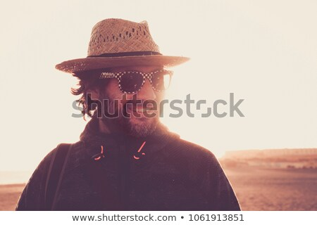 Summer portrait of beautiful woman wearing hat. Vacation at warm Stock photo © HASLOO