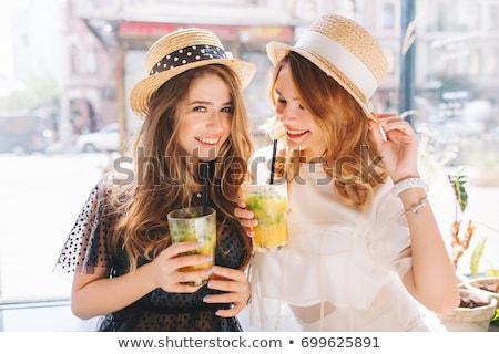 glimlachend · jonge · vrouw · strohoed · strand - stockfoto © hasloo