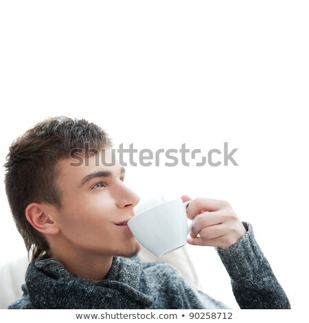 Portrait of a young man drinking coffee and looking away,  lots  Stock photo © HASLOO