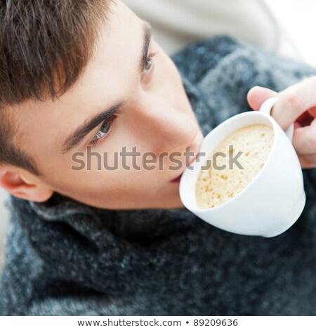 Сток-фото: портрет · молодым · человеком · питьевой · кофе · сидят · кресло