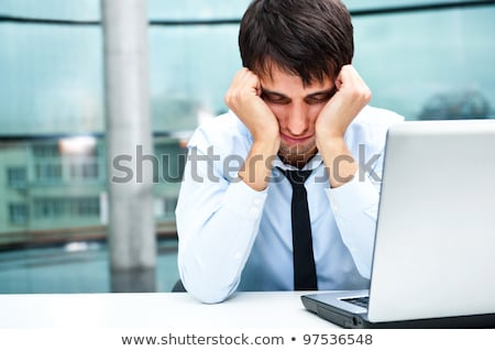 Foto stock: Tired Businessman Sleeping At His Desk In The Office With Both A