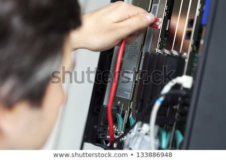 technician on phone in office stock photo © photography33