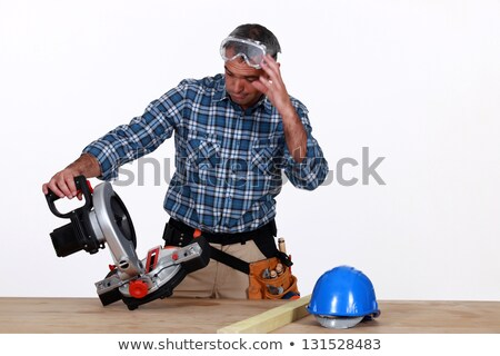 craftsman looking at his new electric saw stock photo © photography33