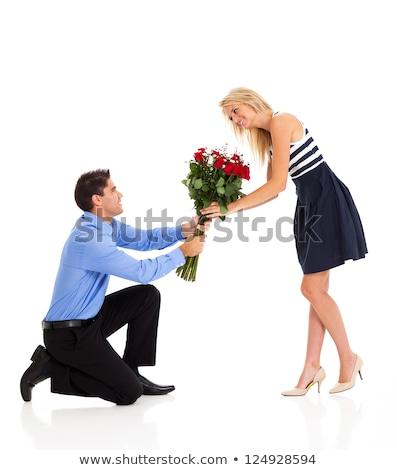 Blonde vrouw geschenk rode rozen verwonderd aantrekkelijk liefde Stockfoto © feverpitch