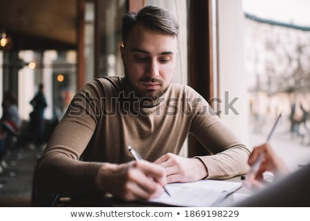 Business colleagues writing in a personal organizer Stock photo © photography33