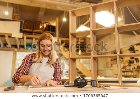 craftswoman holding a wooden piece stock photo © photography33