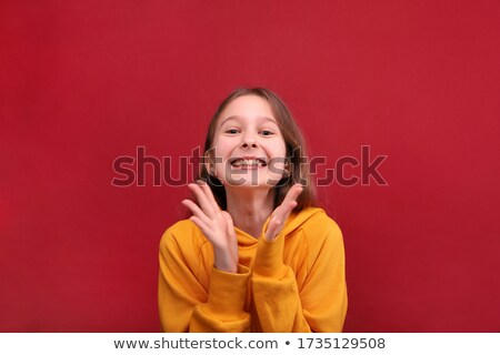 Stok fotoğraf: Delighted Girl Clapping Her Hands