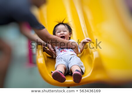 Parents with child at the playground Stock photo © pumujcl
