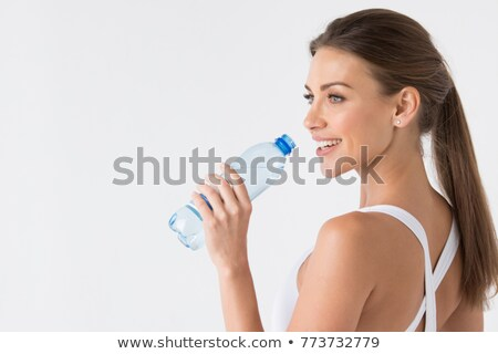 Woman drinking from bottle Stock photo © photography33