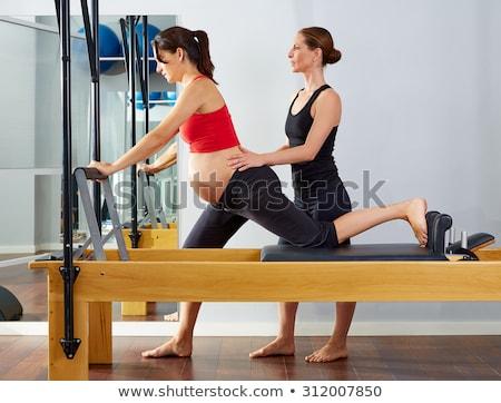 Pilates aerobik oktató nő fitnessz testmozgás Stock fotó © lunamarina