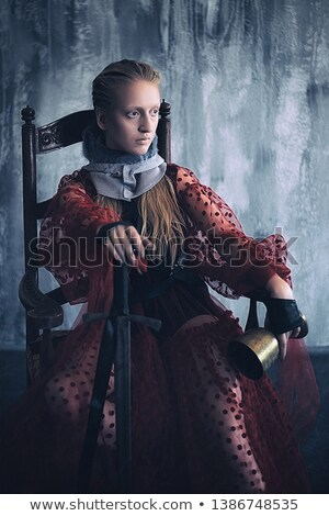 portrait of a medieval lady with sword stock photo © gsermek