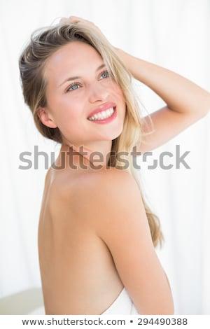 Sarışın kadın havlu oturma uzun bacaklar Stok fotoğraf © stryjek