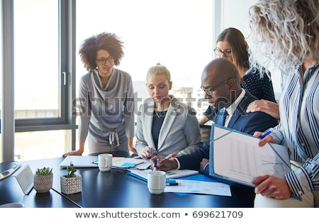 Businesspeople reviewing paperwork Stock photo © photography33