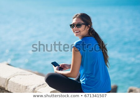 woman sitting and looking back Stock photo © iko