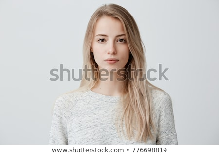 Portrait of pensive young blonde. Isolated stock photo © acidgrey