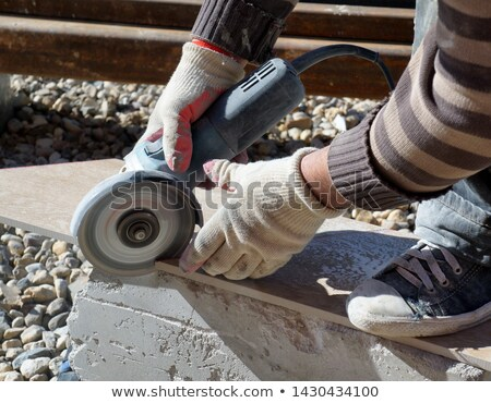 Man holding tile cutting tool Stock photo © photography33