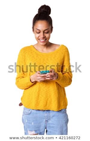 mosolyog · fiatal · női · mobiltelefon · fehér · arc - stock fotó © wavebreak_media
