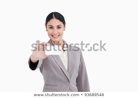 smiling saleswoman presenting her business card against a white background stock photo © wavebreak_media