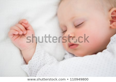 pasgeboren · baby · glimlach · kind · oranje · bed - stockfoto © wavebreak_media