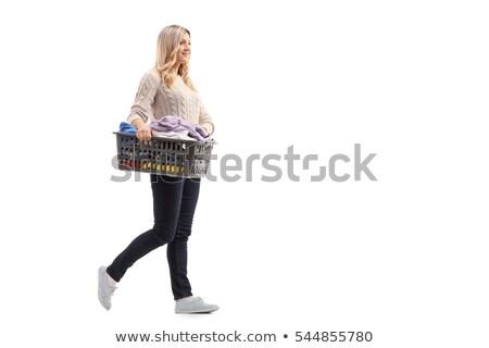 Portré fiatal nő hordoz szennyeskosár teljes alakos fehér Stock fotó © wavebreak_media