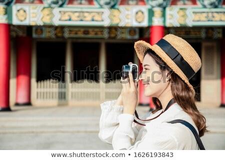 Side view of happy female photographer with photographic camera Stock photo © wavebreak_media