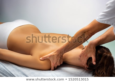 cervical stretching therapy with therapist in woman neck Stock photo © lunamarina