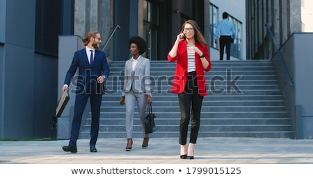 Laughing businesswoman in glasses Stock photo © dash